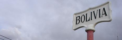 An ornate white sign with the single word, \